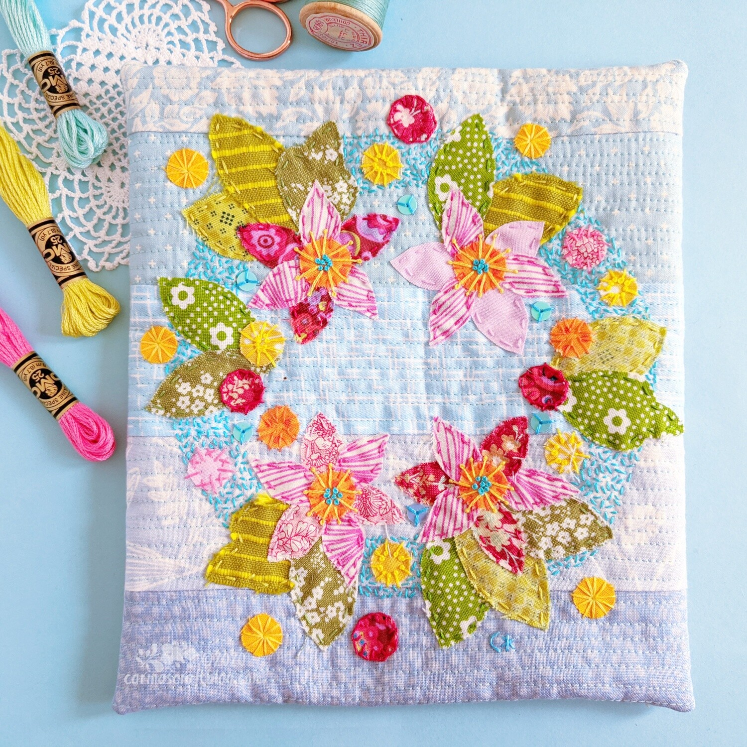 Pink and green appliqué flower wall hanging