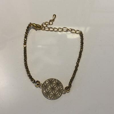 Bracelet hématites dorée et fleur de vie dorée