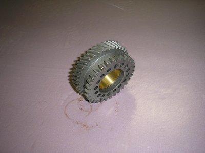 Timing gear wheel with bushing