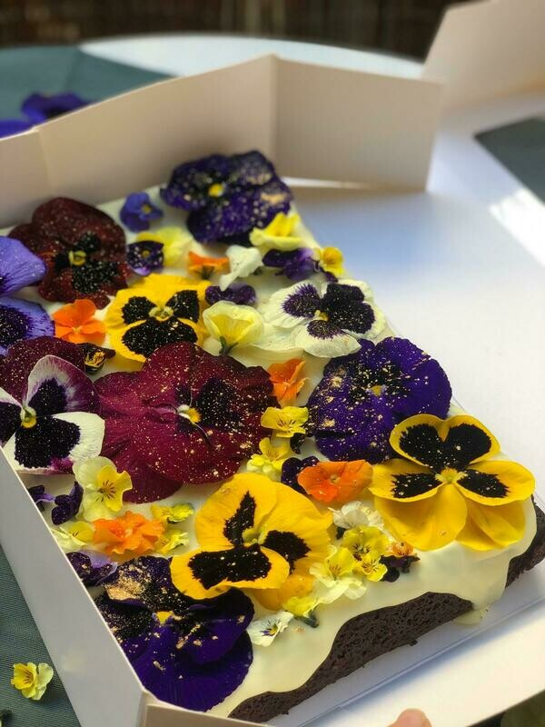 Traditional brownie with edible organic flowers