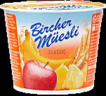 Birchermüesli avec yogourt enrichi de crème, fruits et flocons de céréales