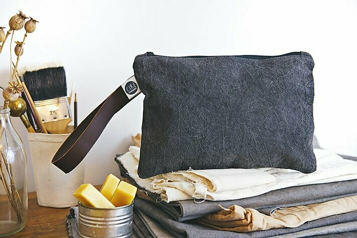 Waxed canvas Washbag with long leather handle by Ciré Bags