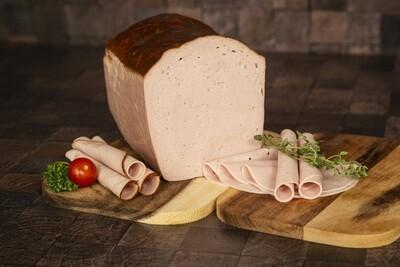 Fleischkäse geschnitten in Schale
