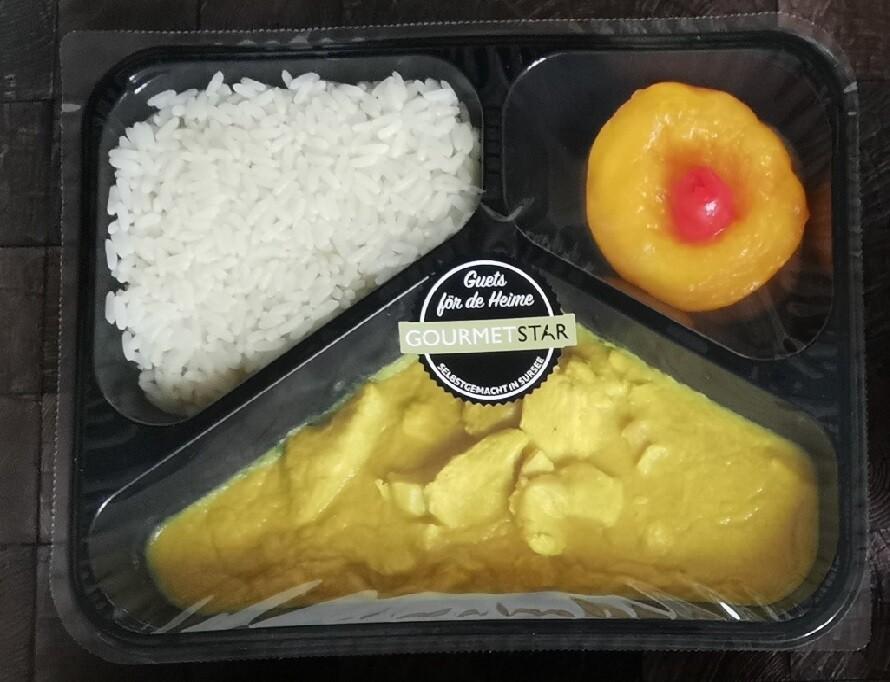 Poulet-Geschnetzeltes an Currysauce mit Reis und Früchten - Exklusiv für Bekon Dagmersellen Mitarbeitende
