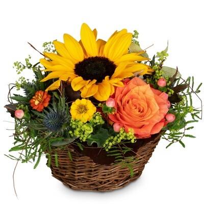 Gesteck in Korb mit Sonnenblumen