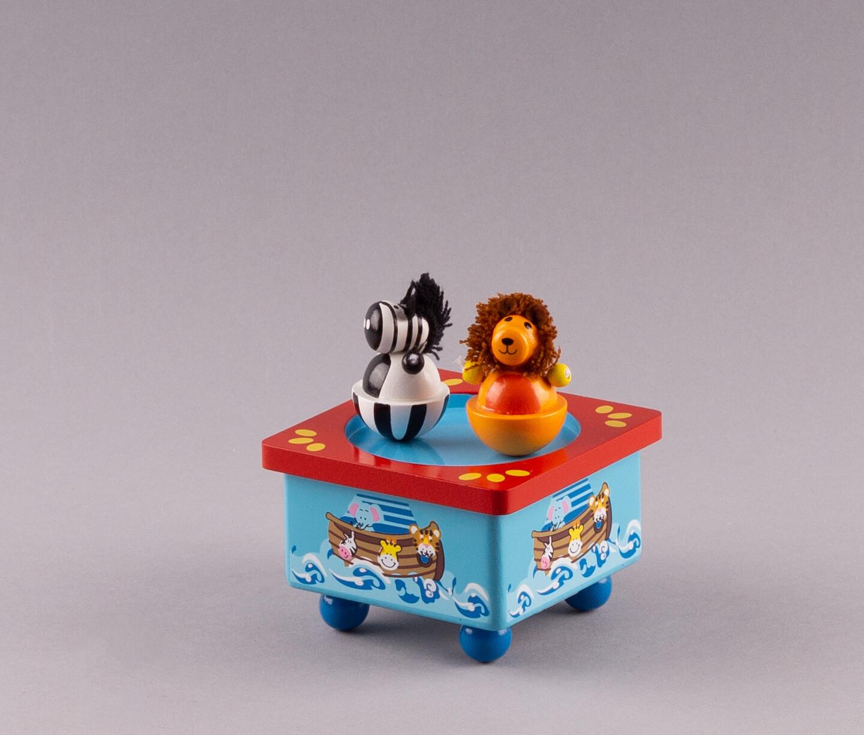 """Holz-Spieluhr """"Zebra und Löwe"""""""