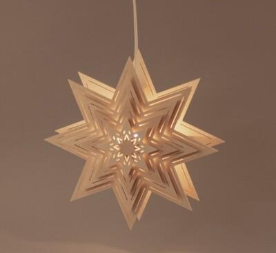 Fensterbild Stern beleuchtet mit Lichtschlitzen