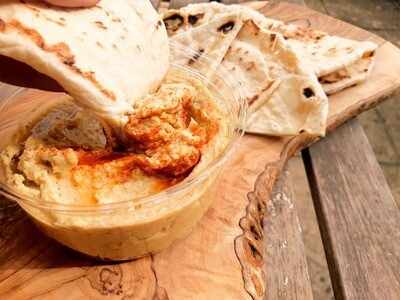 Homemade pitas with roasted garlic hummus