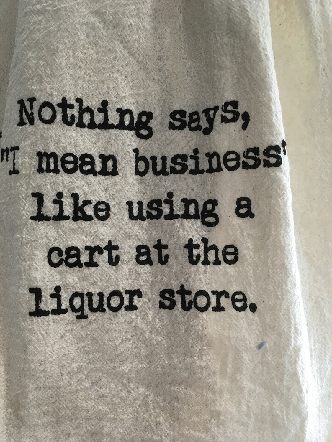 Dish Towel: Business = Using a cart at the liquor store