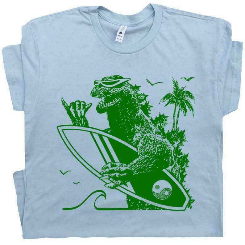 Dinosaur Surfing T Shirt Godzilla Cool Surf T Shirt 80s Vintage Surf Shirt 70s Surfboard Tee Tiki Bar Gift For Retro Surfer Mens Women Kids