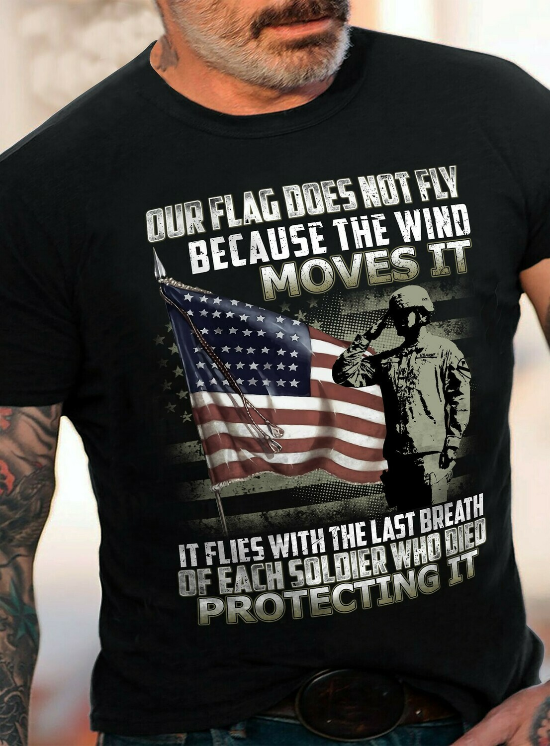OUR FLAG DOES NOT FLY BECAUSE THE WIND MOVES IT T-SHIRT