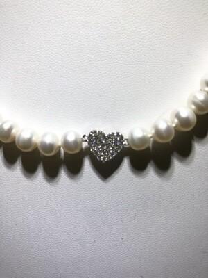 Collana di perle, argento, oro e zirconi.