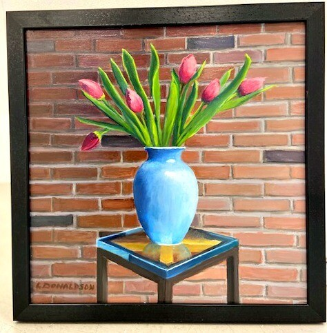 Red Tulips in a Blue Vase
