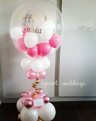 Air filled personalised balloon on a stand.  Arrives inflated