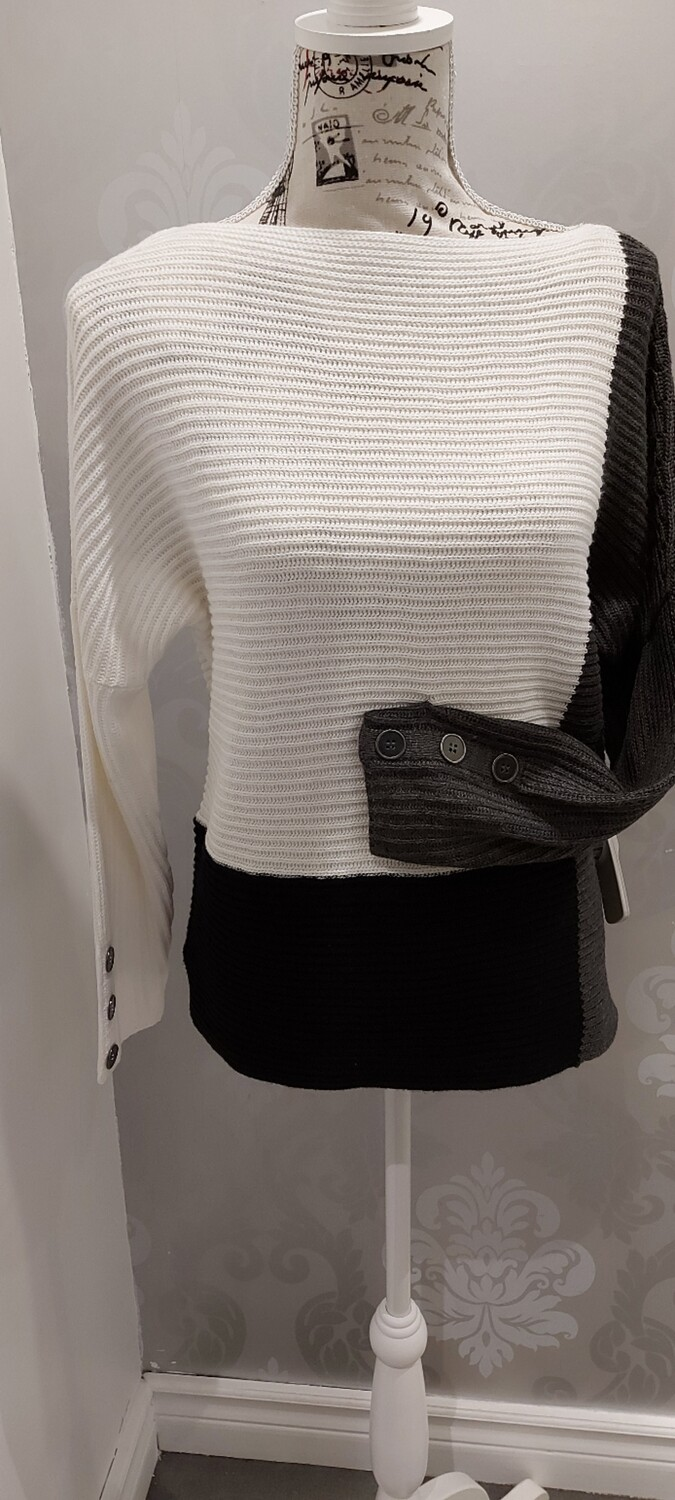 Geometric knit with button cuff details