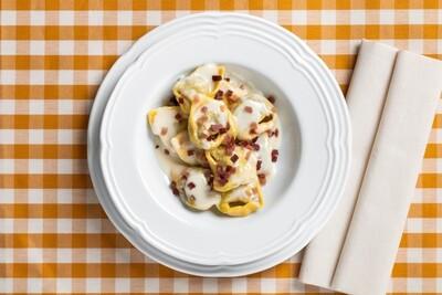 Tortelli ai porcini in crema di parmigiano e fiocco