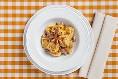 Tortello di zucca alla modenese con noci e pancetta