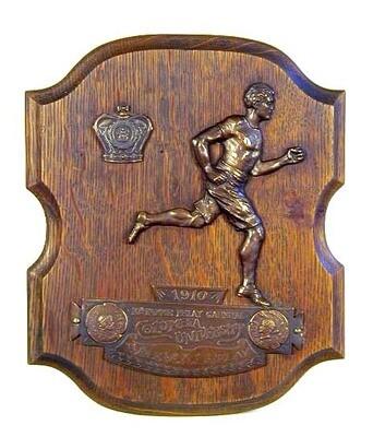 1910 Columbia University Figural Track Trophy