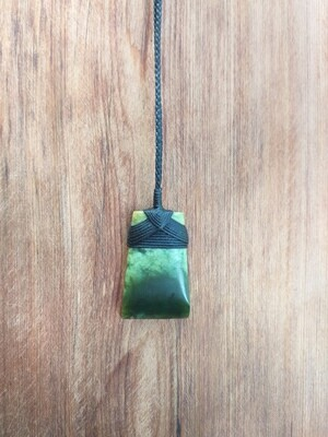 Jade Toki (Adze) pendant bound with cord