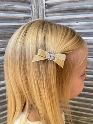 Gouden glanzende strik op clip - goud