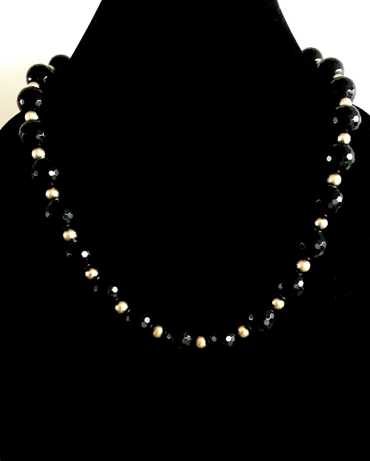 Black faceted and golden beads necklace