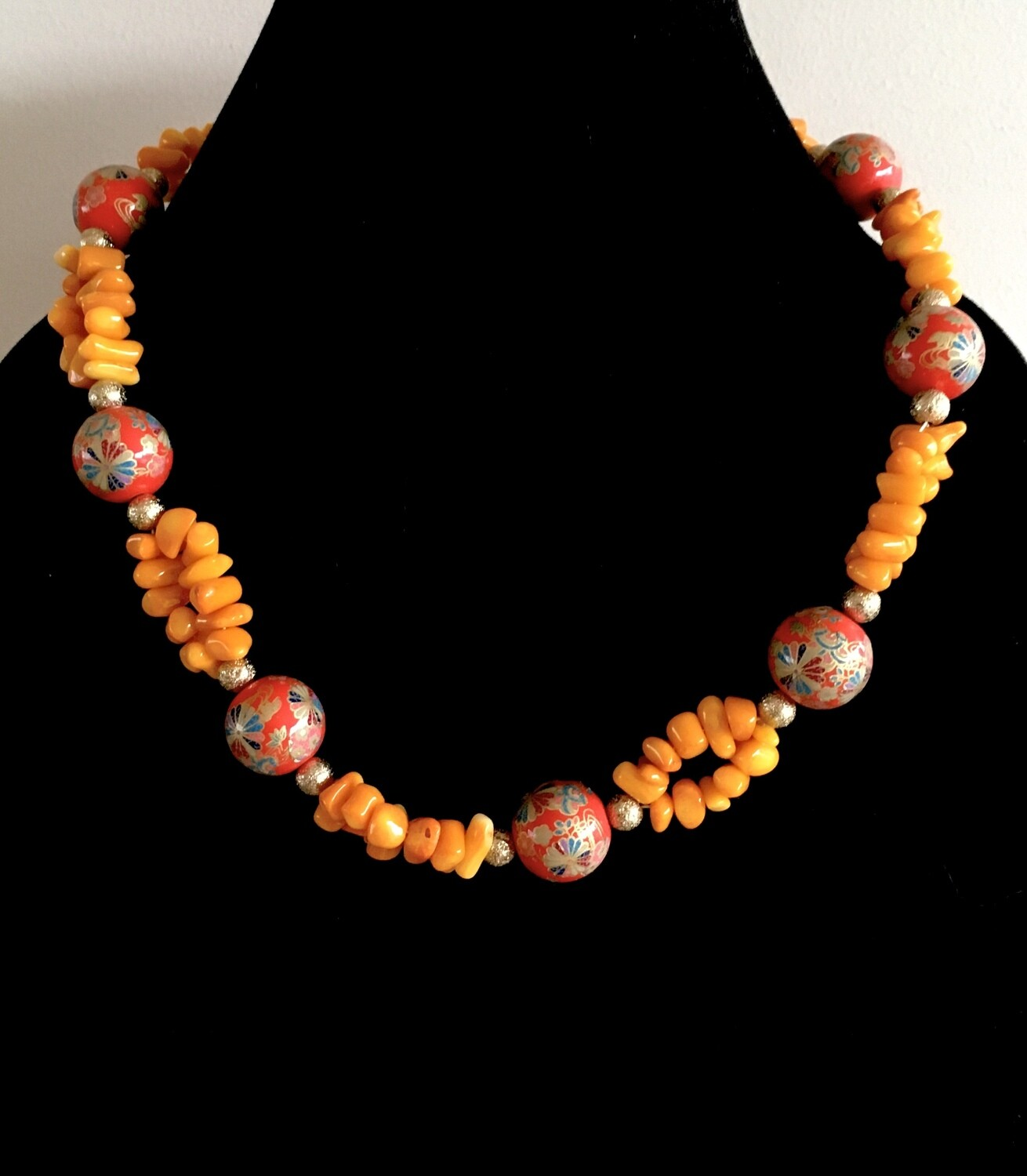 Orange bead and bohemian balls necklace