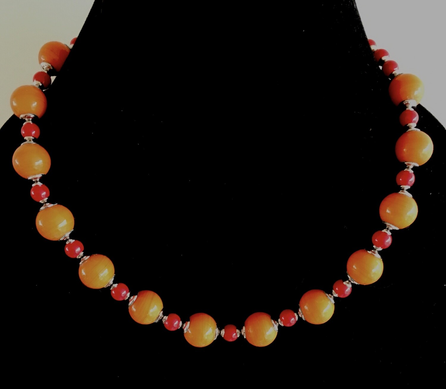 Orange and red shiny glass bead necklace ( with silver plated  spacers)