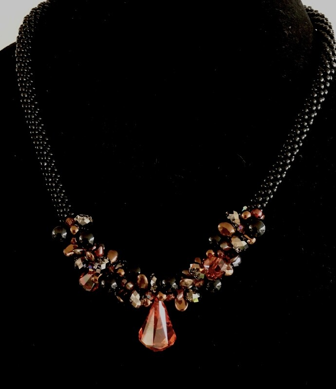 Black and orange Kumihumo necklace ( with faceted crystal pendant)