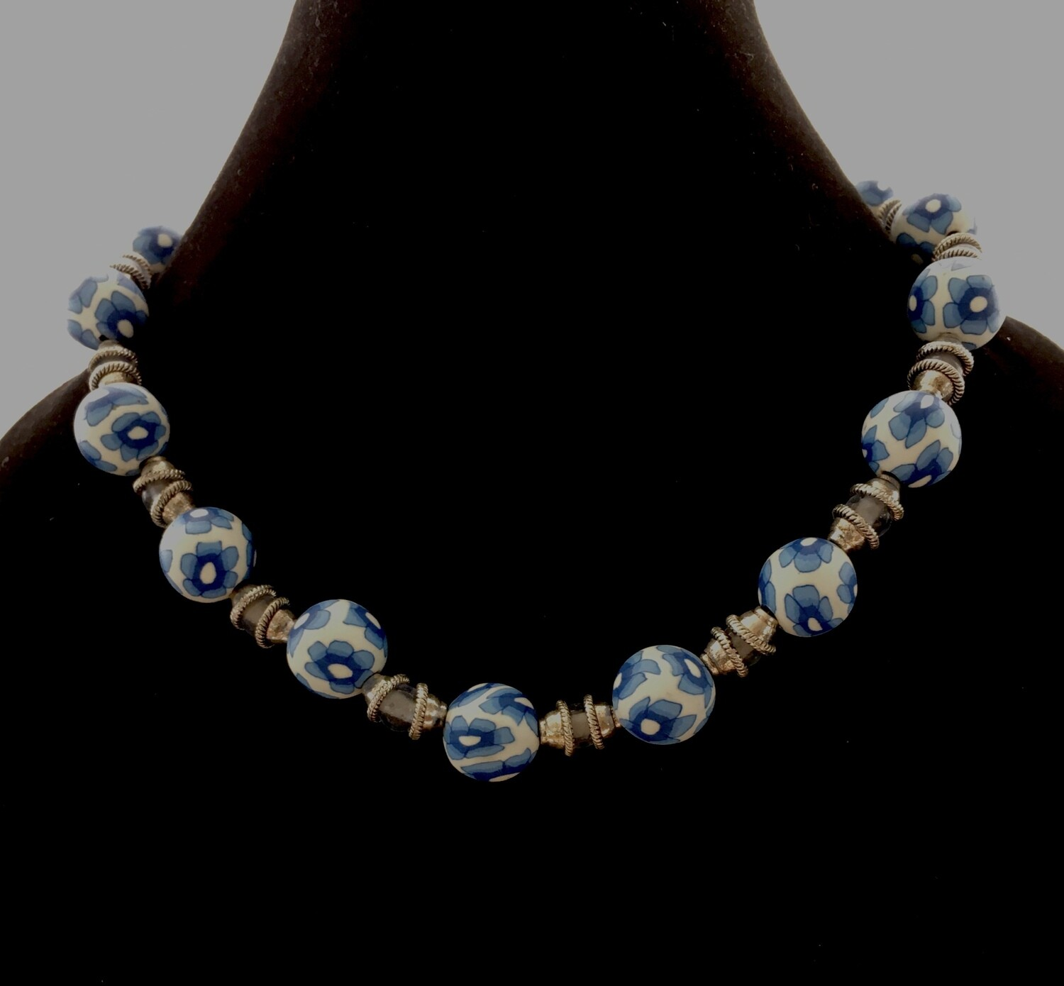 Blue floral pattern beads with silver spacers