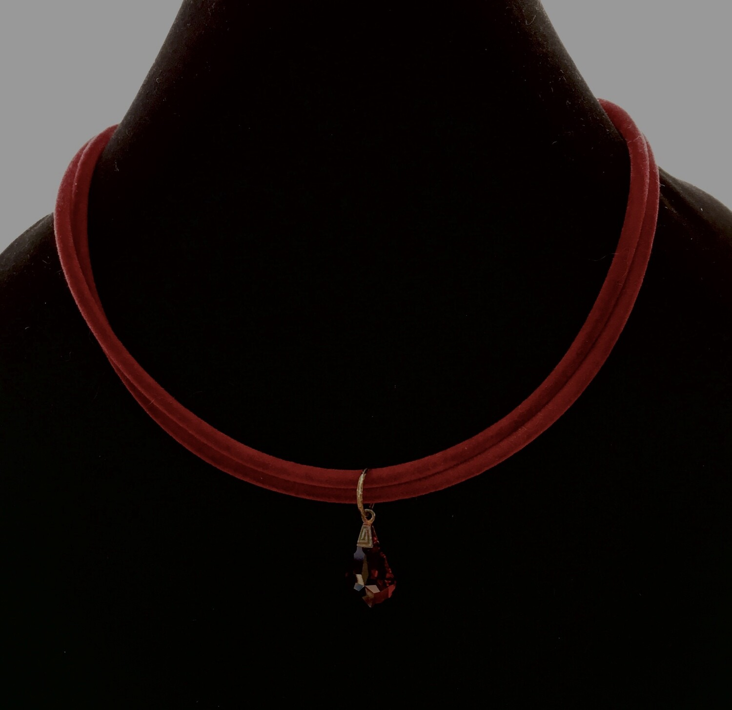 Red cord necklace with crimson crystal pendant