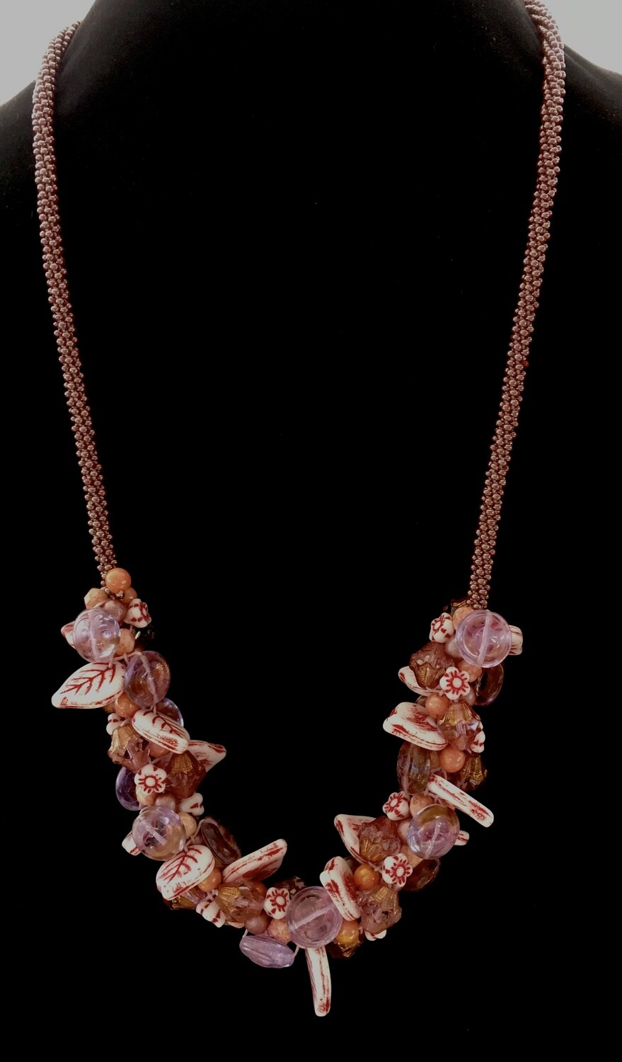 Long Kumihumo necklace with pink leaf and floral cluster beads