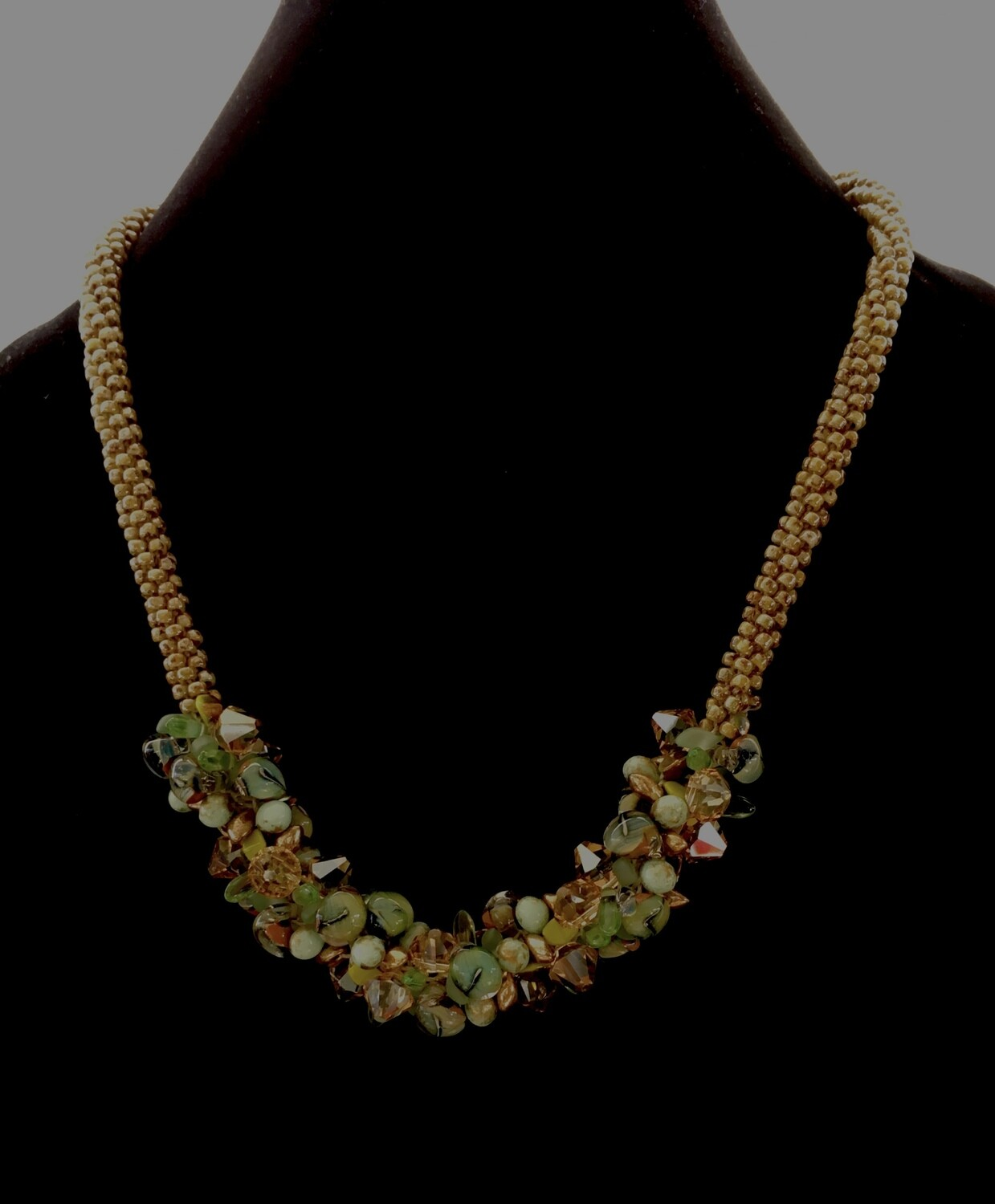 Kumihumo necklace with green floral cluster beads