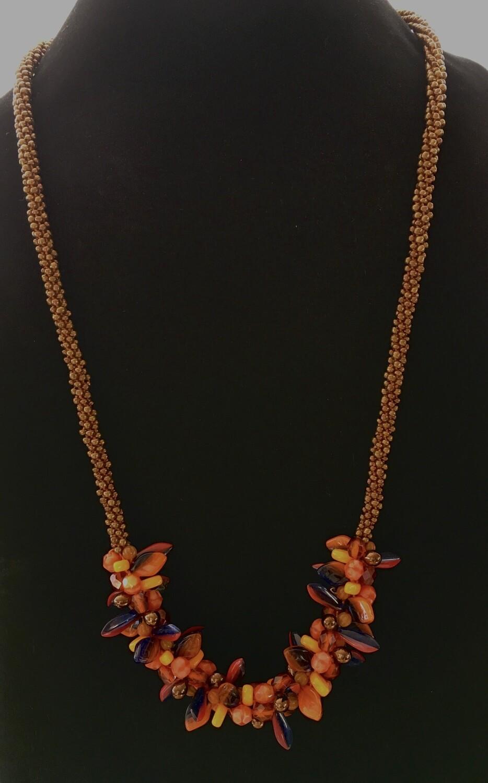 Long Kumihumo necklace with orange and indigo cluster beads