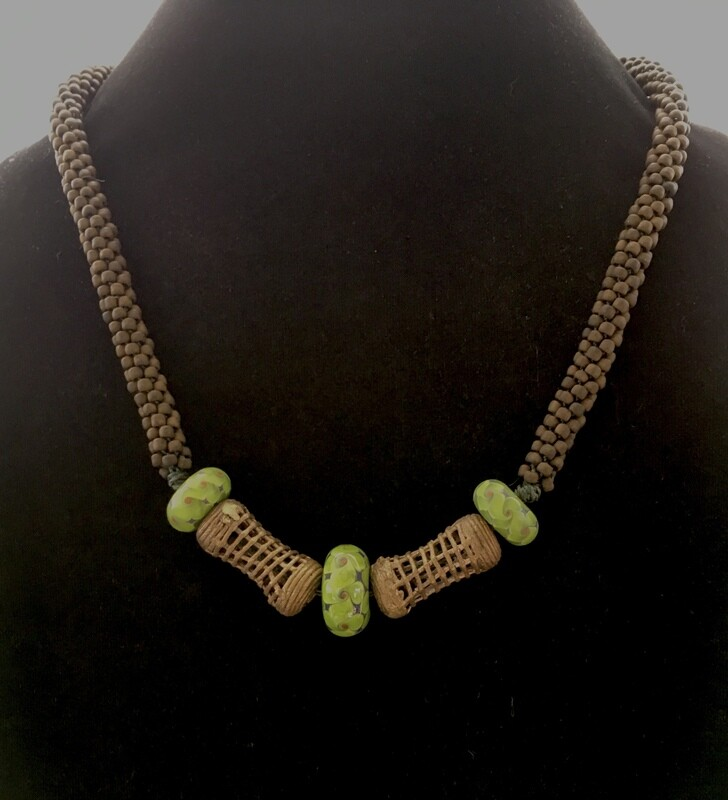 Kumihumo necklace with ethnic bronze and hand made glass beads