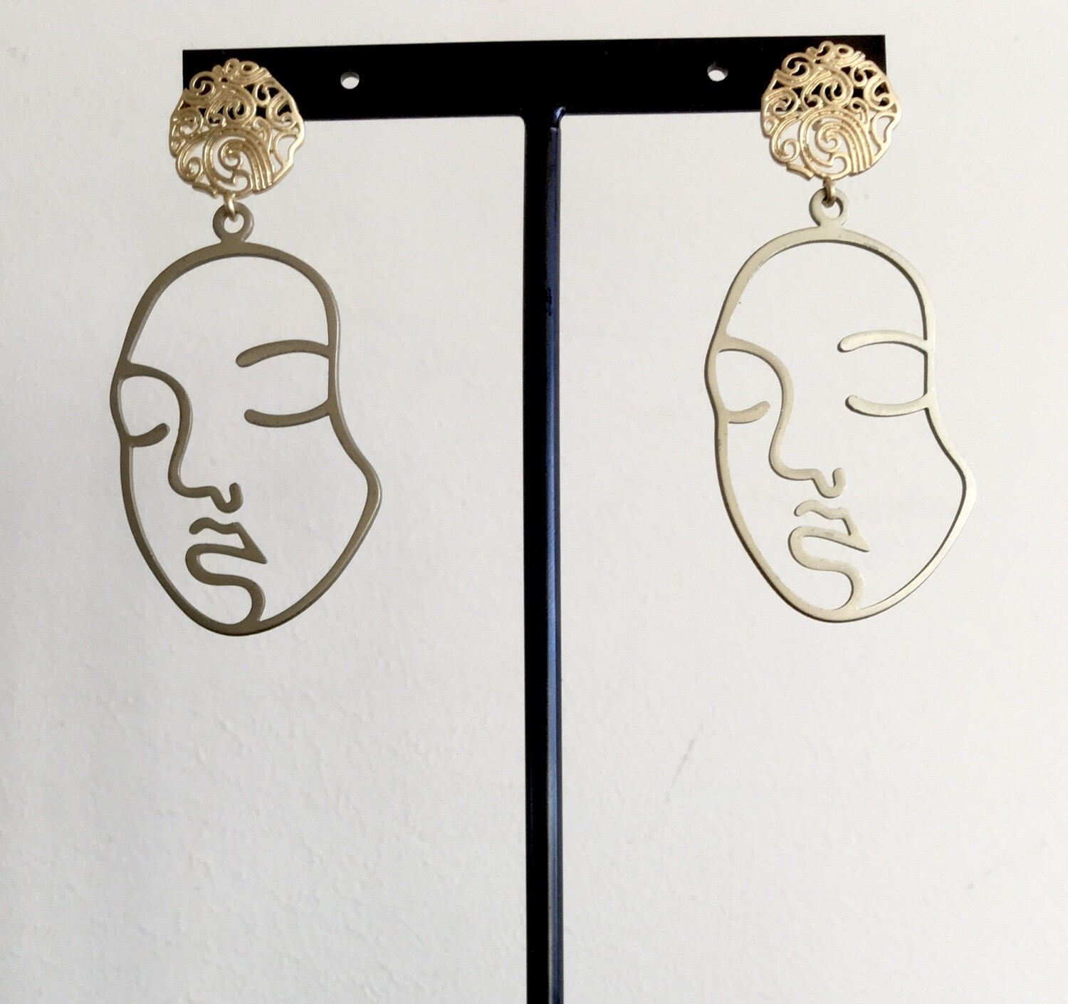 Sleeping face earrings