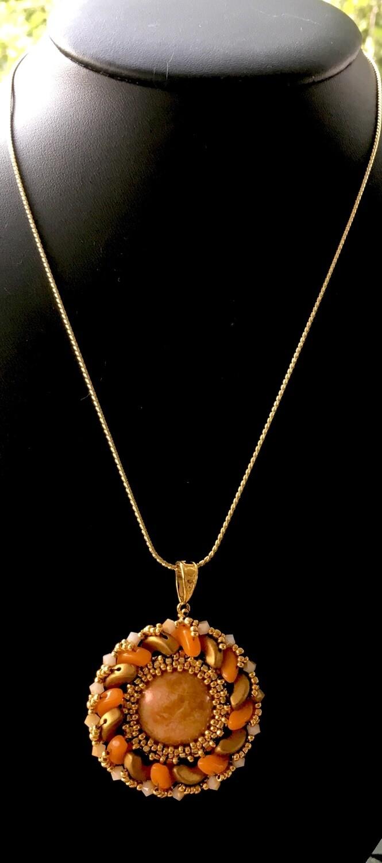 Golden orange medallion pendant