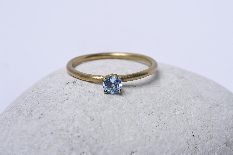 Bague de fiançailles sertie d'une Topaze bleue
