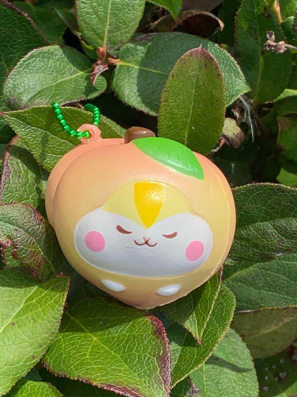 Poli Shimmery Mini Peach Squishy - Yellow / Pink