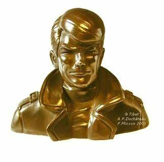 Buste de Ric Hochet, résine et bronze. Dessin : Tibet. Scénario : André-Paul Duchâteau. Sculpture, moulage : François Plisson.