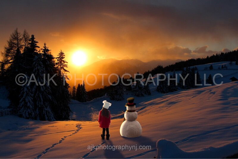 Snowman and child in sunset digital backdrop