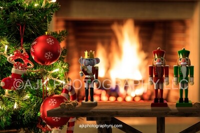 Nutcrackers on table with walnuts in front of fireplace Christmas digital backdrop