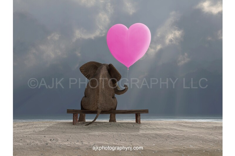 Valentines Day digital background, an elephant sitting on a bench holding a pink heart shaped balloon, beach and ocean, digital backdrop