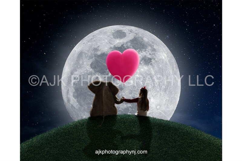 Valentines Day digital background, an elephant sitting on a grassy hill holding a pink heart shaped balloon in front of a large moon digital backdrop