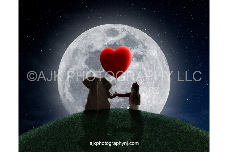 Valentines Day digital background, an elephant sitting on a grassy hill holding a red heart shaped balloon in front of a large moon digital backdrop