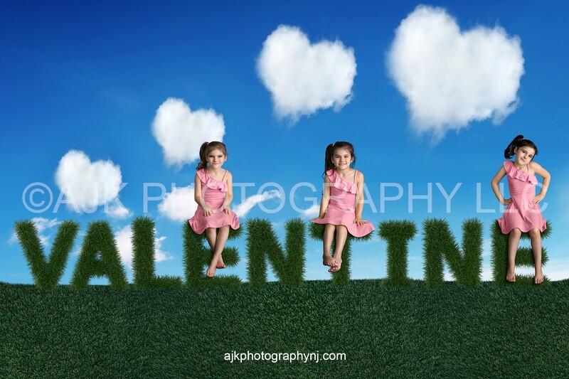 Valentines Day digital background, grass letters spelling valentine, heart shaped clouds, blue sky, digital backdrop