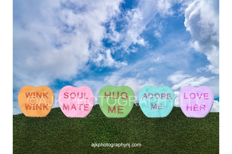 Valentines Day digital background, giant Valentine candy hearts in a grass field, blue sky, digital backdrop