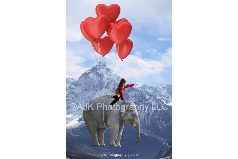 Valentines Day digital background, red heart balloons tied to an elephant, floating above mountain range, digital backdrop