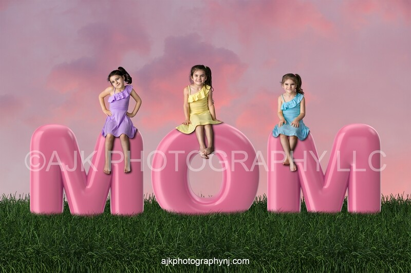 Happy Mother's Day digital background, pink bubble letters spelling MOM in grassy field and pink sky, digital backdrop