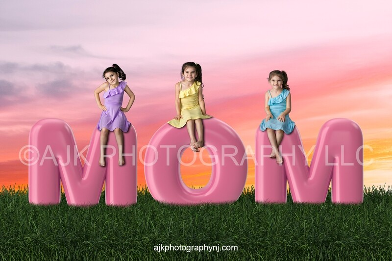 Mother's Day digital background, pink bubble letters spelling MOM in grassy field and pink orange sky, digital backdrop