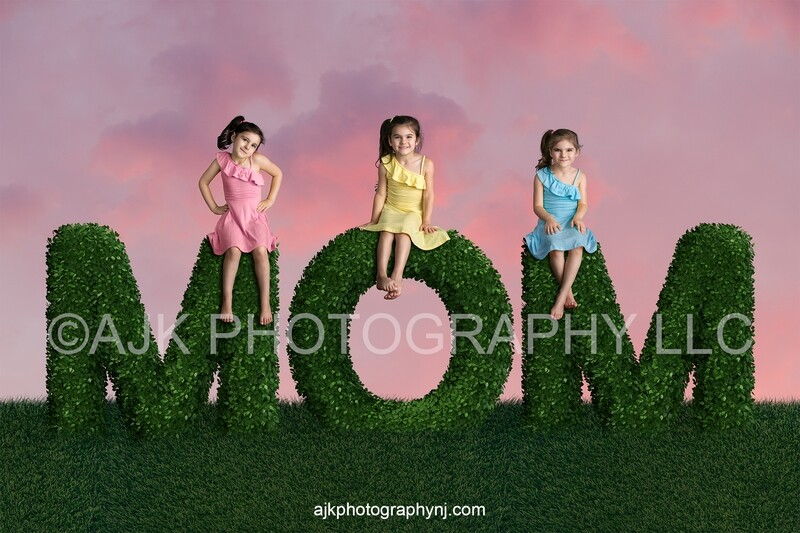 Mother's Day digital background, bush letters spelling MOM in grassy field and pink sky, digital backdrop